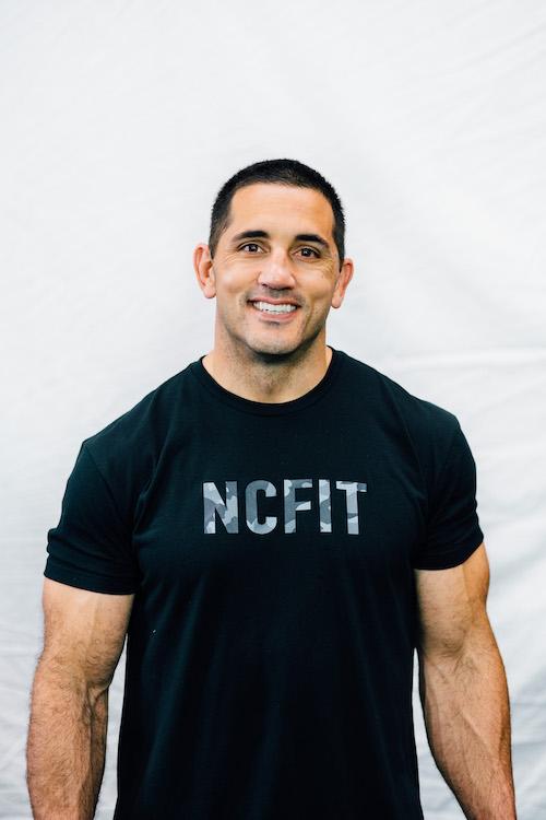 Jason in NCFIT shirt smiling
